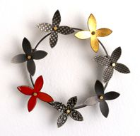 round kinetic flower brooch