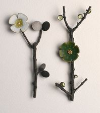 ikebana brooches with white and green enamel
