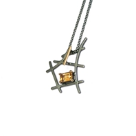 'Black and gold' small rutile formation pendant set with emerald cut citrine