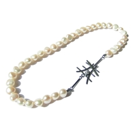 'Monochrome' classic freshwater pearl necklace with unique clasp