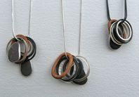 Gracpe Girvan - pebble pendants