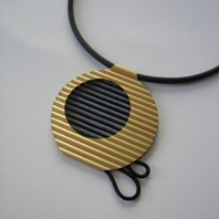 18ct gold sun pendant with black waxed cord