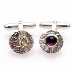 Patterned asymmetrical cufflinks made from tarnish resistant silver and brass and featuring an amethyst gemstone.