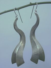 Forged curve earrings white metal