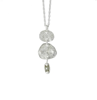 Double disc diamond pendant