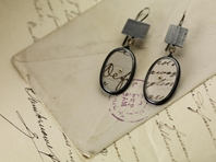 Oval postcard earrings with linear panels