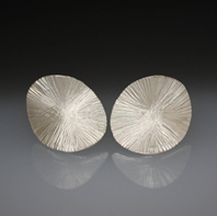 Forged silver oval earrings