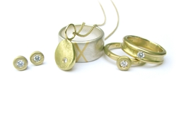 Silver and gold rings and earrings with diamonds by Sally Anne Lowe