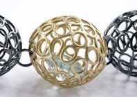 Detail, multiple sphere necklace.