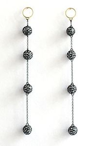 Multiple sphere drop earrings.
