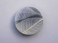 Rubber leaf brooch