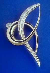 18ct gold and diamond set brooch for the millenium.