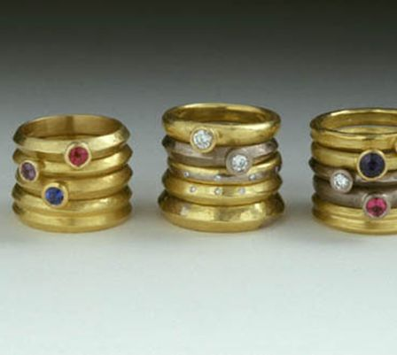 wedding and engagement rings 18ct yellow and white gold with rubies, sapphires and diamonds