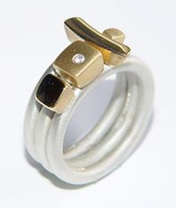 Silver ring with 18ct gold detail & diamond.