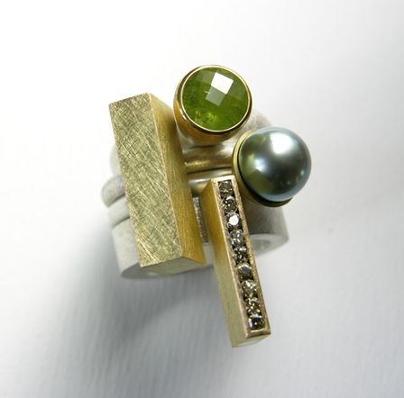 Set of four rings in silver, 18 & 22ct gold, tourmaline, natural-green diamonds and tahitian pearl.