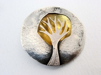 Circular tree dome brooch