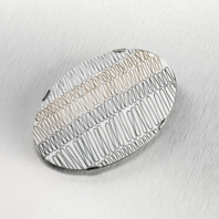 Silver, 9ct gold oval brooch