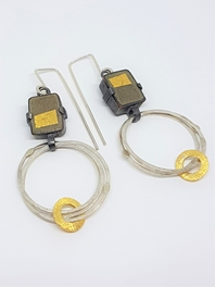 Gold square earrings.